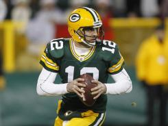 Quarterback Aaron Rodgers tossed five touchdowns in Green Bay's win over Chicago on Sunday night.