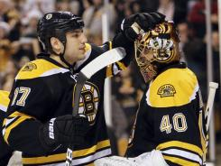 Boston's Milan Lucic, left, congratulates goalie Tuukka Rask after the Bruins shut out the Panthers 8-0 on Friday.