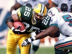 Former Green Bay Packers running back Dorsey Levens, shown here during a game against the Dolphins in 2000, is one of several former players suing the NFL for head-related injuries.