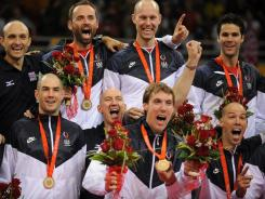 U.S. coach Hugh McCutcheon (center) celebrates with his team after winning the 2008 Olympic gold medal. The USA beat Brazil for the gold medal at the Capital Gymnasium in Beijing.