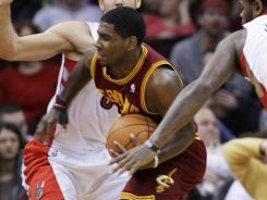 No. 1 overall pick Kyrie Irving was limited to six points on 2-of-12 shooting as the Raptors spoiled his NBA debut.