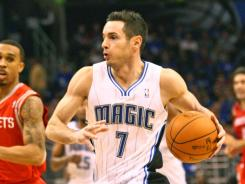 J.J. Redick had 20 points as Orlando had five players in double figures in its first win of the season.