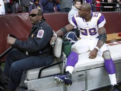 Minnesota Vikings running back Adrian Peterson is driven off the field after an injury during their game against the Washington Redskins.