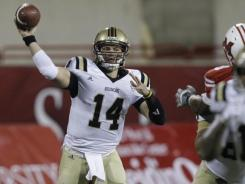 Western Michigan quarterback Alex Carder in action against Miami (Ohio) in an NCAA college football game, Wednesday, Nov. 16, 2011, in Oxford, Ohio.