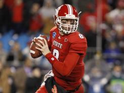 Mike Glennon threw for 264 yards and three TDs to lead N.C. State past Louisville in the Belk Bowl.