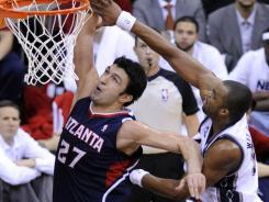 Zaza Pachulia (27) had 13 points and 11 rebounds off the bench for the Hawks as they cruised by the Nets.