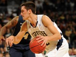 Alex Dragicevich scored a career-high 22 points, and Notre Dame opened Big East play with its 28th consecutive home win.