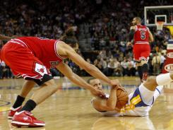 Golden State Warriors guard Stephen Curry, right, tweaked an ankle Monday vs. the Chicago Bulls and will miss Wednesday's game vs. the New York Knicks.