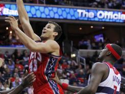 Opening night was not pleasant for Washington Wizards forward Andray Blatche, right, who didn't like the play-calling, and New Jersey Nets forward Kris Humphries, left, who was jeered by the Washington crowd.