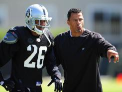 """This is the closest thing to competing,"" says Raiders cornerbacks coach Rod Woodson, instructing Stanford Routt on Aug. 4."
