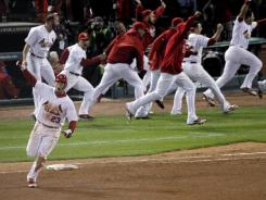 Cardinals' David Freese reacts after hitting a solo home run in the 11th inning of Game 6 of the World Series.