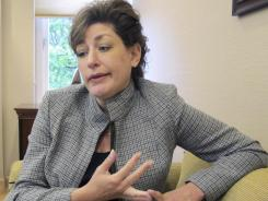 University of Connecticut President Susan Herbst is preaching caution and restraint in college sports following a year of corruption.