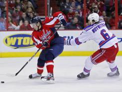Alexander Semin, left,  skates with the puck as New York's Jeff Woywitka (6) tries to chase him down. Semin scored two goals in the Capitals' 4-1 win over the Rangers.