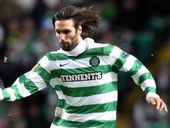 Celtic and forward Giorgos Samaras, right,  are atop the Scottish Premier League after beating Glasgow rival Rangers on Wednesday.