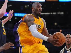 Kobe Bryant scored 26 points to lead the Lakers past the Jazz for their first win of the season.