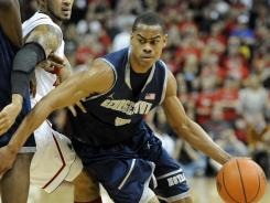 Georgetown guard Markel Starks dribbles past Louisville guard Peyton Siva during the first half at the KFC Yum! Center.