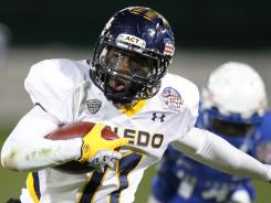 Toledo wide receiver Bernard Reedy runs for the winning touchdown against  Air Force during the Military Bowl at RFK Stadium in Washington.