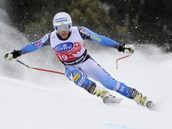 Bode Miller of the USA competes and takes fifth place during the Audi FIS Alpine Ski World Cup men's downhill on Thursday in Bormio, Italy.