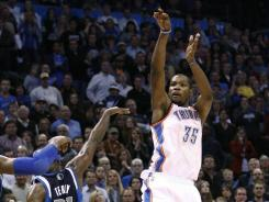 Kevin Durant rises and releases over Jason Terry for a game-winning three-pointer. The Thunder beat the Mavericks on this shot 104-102.