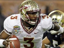 Florida State quarterback EJ Manuel (3) scrambles away from Notre Dame linebacker Manti Te'o during the first half of the Champs Sports Bowl in Orlando.