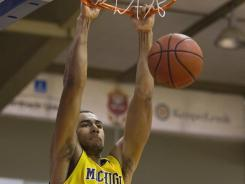 Michigan forward Jon Horford dunks during the second half of an NCAA college basketball game Monday, Nov. 21, 2011, in Lahaina, Hawaii. Michigan defeated Memphis 73-61.