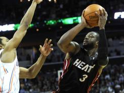 Dwyane Wade sets up to take the winning shot Wednesday against the Bobcats. The NBA said Wade's shot was not predicated by an uncalled traveling violation.