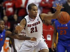 Rutgers' Austin Johnson (21) tries to control the ball in front of Florida's Erving Walker during the first half  in Piscataway, N.J.,