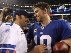 The Cowboys' Tony Romo, left, and The Giants' Eli Manning will duel for the NFC East title on Sunday.
