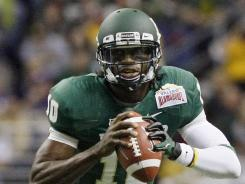 Baylor quarterback Robert Griffin III looks to pass during the first half of the Alamo Bowl in San Antonio.