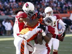 Arizona Cardinals defensive end Darnell Dockett (90) helps take down Bengals tight end Jermaine Gresham (84) during their game on Dec. 24.