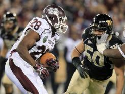 Mississippi State running back Vick Ballard (28) managed to get past Wake Forest defensive tackle Nikita Whitlock (50) en route to a 60-yard touchdown run in the first quarter of the Music City Bowl in Nashville on Friday.