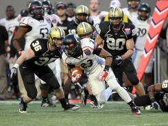 Cincinnati running back Isaiah Pead (23) tries to elude defenders during the second half against Vanderbilt at Liberty Bowl Memorial Stadium. Pead rushed for 149 yards and one touchdown.