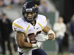 West Virginia Mountaineers running back Dustin Garrison runs with the ball during the second quarter against the South Florida Bulls at Raymond James Stadium.