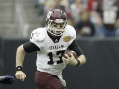 Texas A&M quarterback Ryan Tannehill runs the ball against Northwestern during the Aggies' 33-22 win in the Meineke Car Care Bowl.