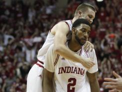 Jordan Hulls, back, had 17 points and Christian Watford 10 as five Hoosiers scored in double figures.