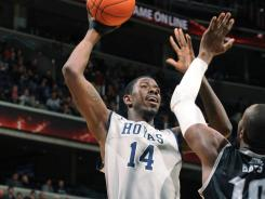 Henry Sims (14) scored five points in the final seven minutes as No. 12 Georgetown avoided the upset against Providence.
