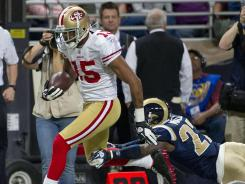 Michael Crabtree (15) caught a pair of touchdown passes to help San Francisco lock up the No. 2 seed in the NFC.