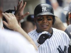 Andruw Jones, who hit .247 with 13 home runs in 2011, remained with the Yankees by agreeing to a one-year deal.