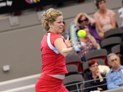 Kim Clijsters of Belgium hits a forehand return during her match against Simona Halep of Romania at the Brisbane International. Clijsters won the match 6-1, 6-4.