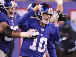 Eli Manning had reason to celebrate as the Giants captured the NFC East crown. Manning threw for 346 yards and three touchdowns.