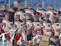 The New York Rangers gather for a team photo Sunday before the start of practice for the Winter Classic.