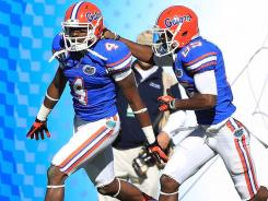 Florida wide receiver Andre Debose (4) celebreates after returning a kickoff for a touchdown the first half.