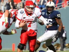 Case Keenum scrambles for yardage on this play, but it was his passing that helped Houston knock off Penn State.