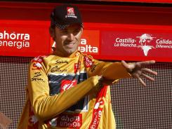 Spanish cyclist Alejandro Valverde puts on the yellow jersey on the podium of the Vuelta  on Sept. 20, 2009 in Madrid. Valverde recently served a doping suspension.