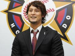 Yu Darvish, seen here at a January 2011 press conference, spent Tuesday in Texas according to Rangers GM Jon Daniels.