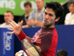 Fernando Verdasco hits a return against Wu Di during their match on day four of the Hopman Cup in Perth, Australia.