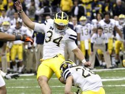 Michigan kicker Brendan Gibbons kicks the game-winning field goal in overtime at the Allstate Sugar Bowl at Mercedes-Benz Superdome in New Orleans.