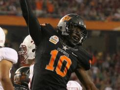 Oklahoma States' Markelle Martin celebrates after recovering a fumble in the third quarter during the Tostitos Fiesta Bowl in Glendale, Ariz.