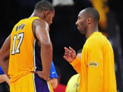 Kobe Bryant, right, seen here talking to Andrew Bynum (17) during a timeout, scored 37 points in the Lakers' win over the Rockets on Tuesday. Bynum notched the first 20-20 game of his career, going for 21 points and 22 rebounds.