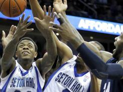 Seton Hall players Fuquan Edwin (23) and Brandon Mobley (2) reach for a rebound during the first half in Newark.
